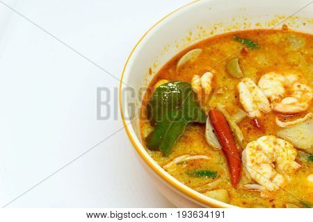 Home Made River prawn spicy soup in bowl or Tom Yum Kung. thai spicy food. with copy space