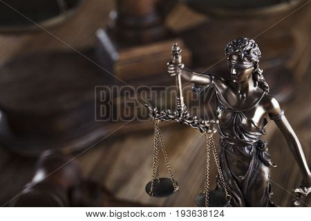 Law and justice concept, Themis and gavel on wooden table.