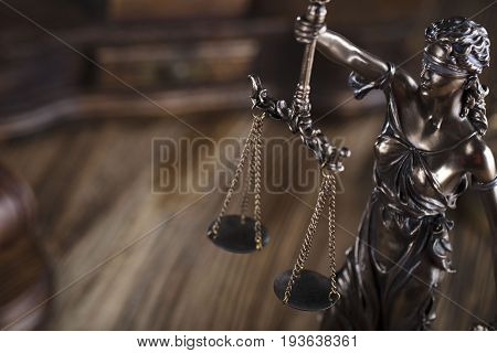 Lawyer office, Themis and scale of justice on wooden table.