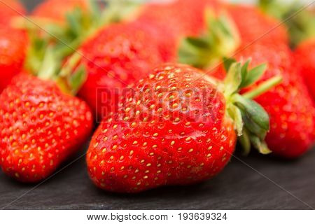 a closeup image of a group of fresh strawberries