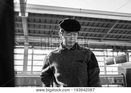 KYOTO, JAPAN - NOVEMBER 11, 2016: People on the way for a train on the main station in Kyoto, Japan. West Japan Railway (JR West) is one of the biggest railway companies in Japan.