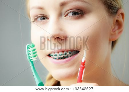 Girl With Teeth Braces Using Interdental And Traditional Brush