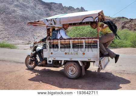 Hormuz Island Hormozgan Province Iran - 17 april 2017: Iranian Island of Hormuz in Persian Gulf Travelers use a three-wheeled motorcycle van for a trip around the island.