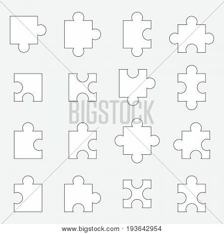 Set of white jigsaw puzzle piece on gray background