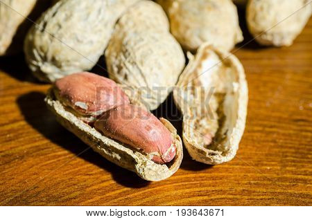 Peanut in shell on dark wooden background. Close up. Selective focus. Peanut.