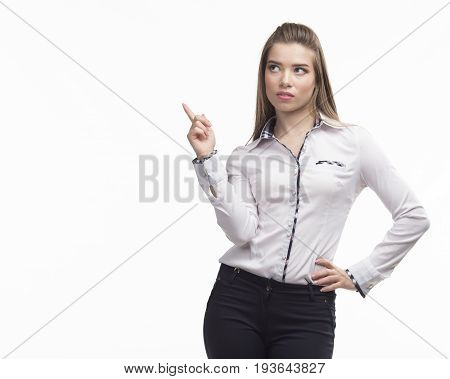 Young wistful woman showing by hands on a gray background. Ideal for banners, registration forms, presentation, landings, presenting concept..