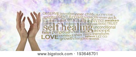 Self Healing Word Cloud Banner - female cupped hands reaching upwards  on a subtle  pastel multicolored bokeh background with a gold SELF HEALING word cloud to the right