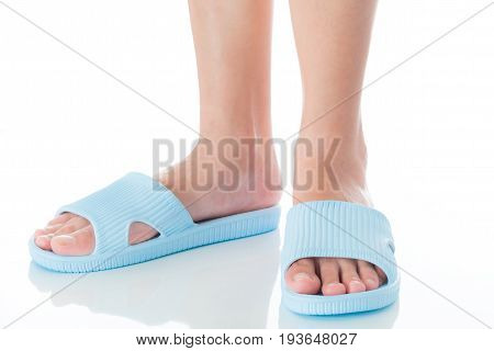 Woman feet wearing beautiful blue sandal standing with side view on white background Fashion woman concept.