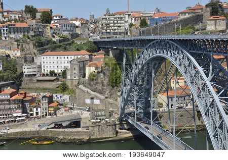 PORTO, PORTUGAL - AUGUST 7, 2015: The bridge of Dom Luiz and the surrondings of the city seen from Gaia in Porto Portugal.