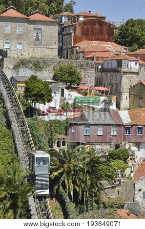 PORTO, PORTUGAL - AUGUST 7, 2015: People descending at the funicular railway in the old town of Porto in Portugal.