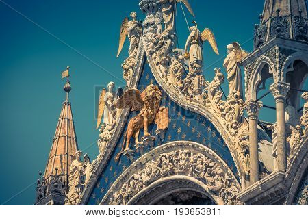 Facade of the Basilica di San Marco (Saint Mark's Basilica) in Venice, Italy. The winged lion is a symbol of Venice.