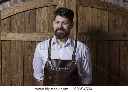 Portrait of cheerful  bartender standing and smiling in bar