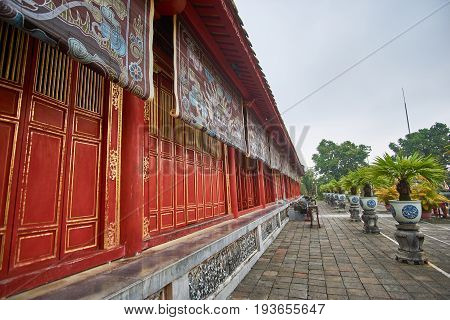 Traditional vietnamese tempel wall with colorful paintings in Hue citadel, Vietnam