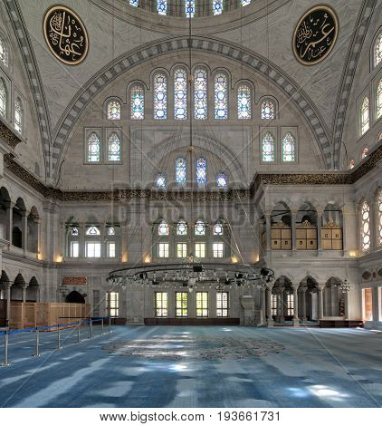 Istanbul, Turkey - April 20, 2017: Interior of Nuruosmaniye Mosque an Ottoman Baroque style mosque built in 1755 with a huge arches & many colored stained glass windows located in Shemberlitash Fatih Istanbul Turkey