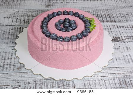 pink carrot chocolate velour mousse cake with blueberry