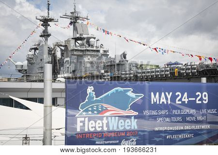 Ship Tour USS Kearsarge (LHD 3) Wasp-class amphibious assault ship: Fleet Week sign at the Intrepid Sea, Air & Space Museum on Pier 86N. Fleet Week NEW YORK MAY 25 2017.