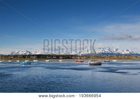Boats in the bay in front of the city of Ushuaia in Tierra del Fuego Argentina