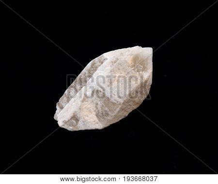 Rare dreamsicle lemurian quartz point on black background