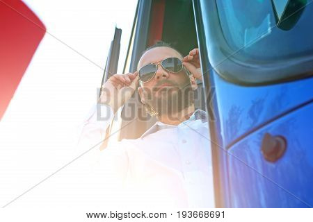 Driver. A handsome bus driver in the bus
