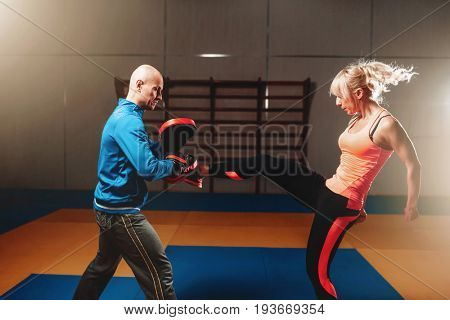 Woman in actoin on self defense workout