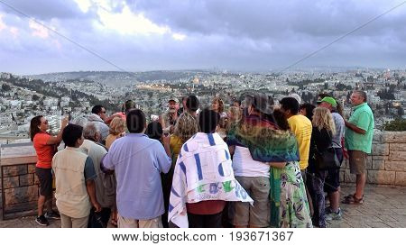 Jerusalem, Israel - May 20, 2017: The guide shows the Jerusalem Old City view to the tourists and pilgrims. Mount Scopus is a famous Holy Land place and it has a fantastic view to the Old Jerusalem.