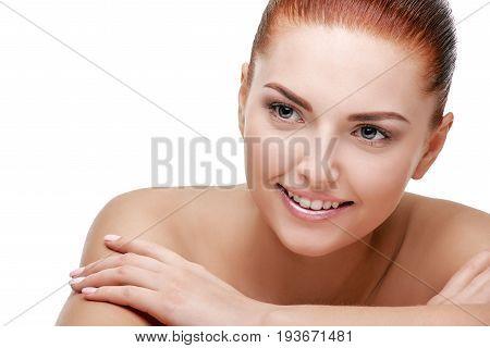 Beautiful happy woman touching skin on her shoulders