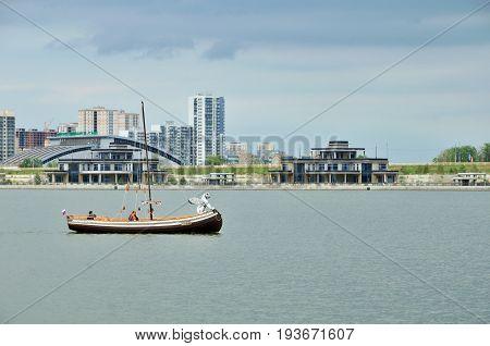 Kazan, Tatarstan, Russia - 2 July, 2017. View of Novo Savinovsky district of the city of Kazan, the river Kazanka.