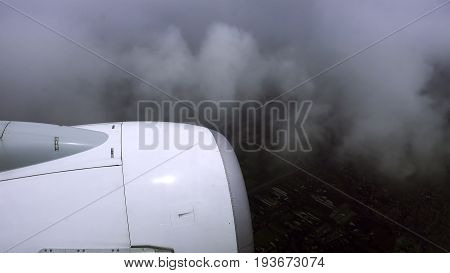 Airliner is flying in a bad weather conditions. Non-flying weather flight.