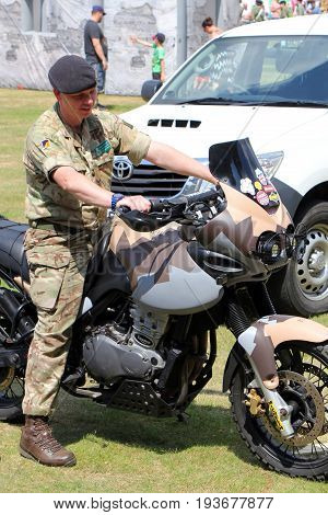Sandhurst, Surrey, Uk - June 18Th 2017: British Army Motorcyclist With Triumph Motorbike At The Sand
