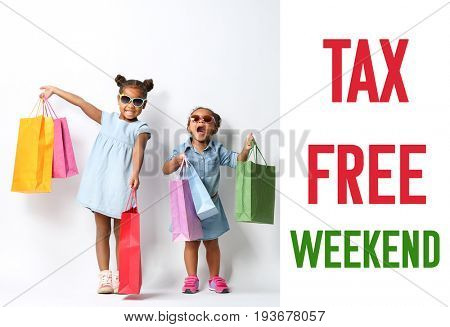 Cute African girls with shopping bags and text TAX FREE WEEKEND on white background