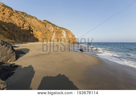 Afternoon view of secluded Pirates Cove beach at Point Dume State Park in Malibu, California.