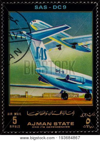 Moscow Russia - July 03 2017: A stamp printed in Ajman shows passenger airliner Douglas DC-9 series