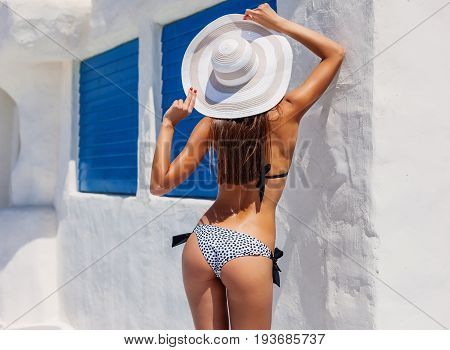 Sexy Back Of A Beautiful Tanned Slim Woman In Bikini On White And Blue Background. Mediterranean Arc