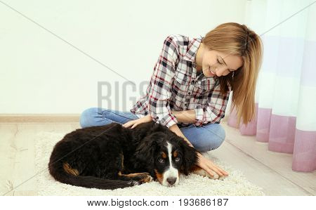 Young woman with cute funny dog at home