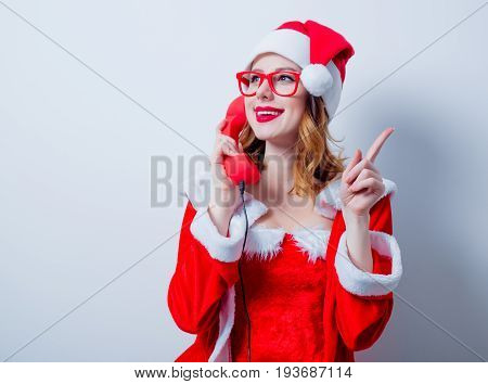 Santa Claus Girl With Eyeglasses And Handset