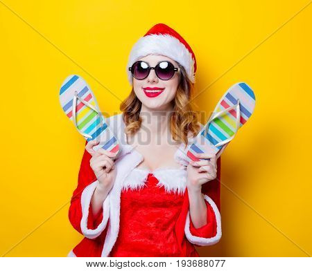 Santa Clous Girl With Sunglasses And Flip Flops