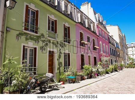 Rue Cremieux Paris in the 12th Arrondissement of Paris is a place of pastel coloured houses and shutters, a quirky little street in the centre of the city. poster
