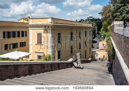 Rome Italy - August 18 2016: Lateral staircase to Piazza della Trinita dei Monti with artist painting a sunny summer day. It is a main square in the historical centre of Rome.