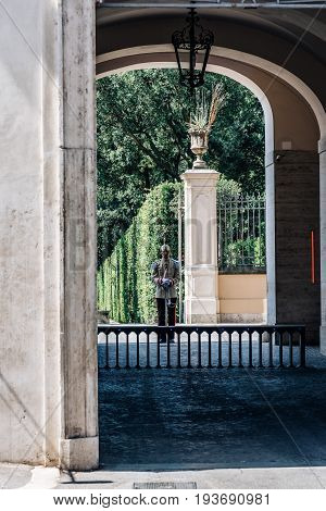 Rome Italy - August 18 2016: Soldier guarding the door of The Quirinal Palace. It is a historic building in Rome official residence of the President of the Italian Republic.