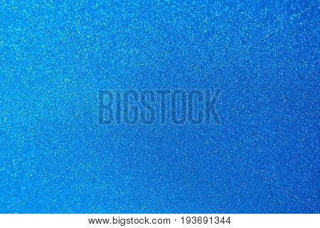 Light blue metal car paint surface. Metal matte blue wallpaper background