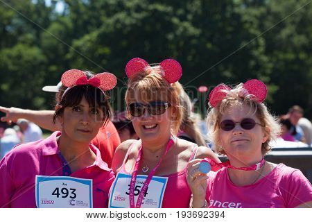SOUTHAMPTON UK - July 2 2017: Race for Life women run and walk to raise money for Cancer Research charity in Southampton UK. Women dressed up with ears wearing medals.