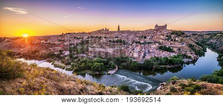 Aerial top view of Toledo, historical capital city of Spain in sunset