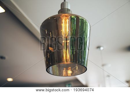 Incandescent lamps in a modern cafe. Edison lamp.