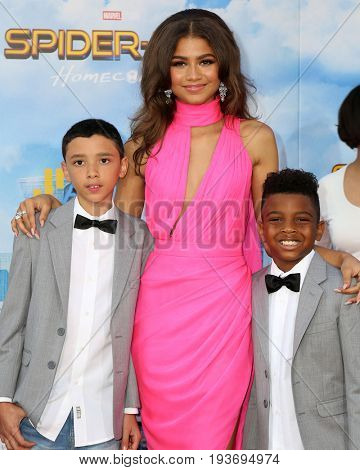 LOS ANGELES - JUN 28:  Zendaya Coleman, brothers at the