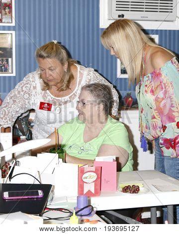 LOS ANGELES - JUL 1:  Laurie Kagan, Volunteer, Katherine Kelly Lang at the