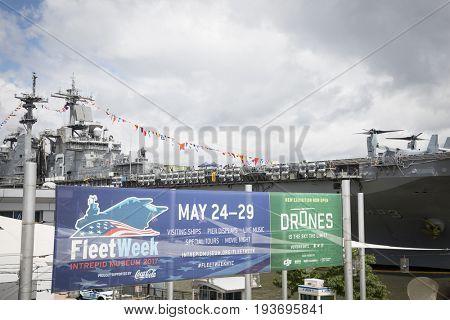 Ship Tour USS Kearsarge (LHD 3) Wasp-class amphibious assault ship: Fleet Week sign at the Intrepid Sea, Air & Space Museum on Pier 86N. Fleet Week NEW YORK MAY 25 2017.