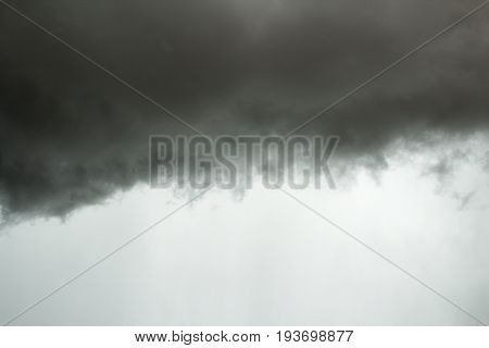 Black cloud in to the storm. Dark clouds rain storms are forming
