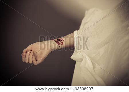 Dead Boy With Bleeding Slit Wrists In A Morgue