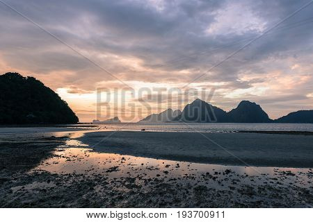 EL NIDO, PALAWAN, PHILIPPINES - MARCH 29, 2017: Colorful sky at the sunset of Las Cabanas Beach.