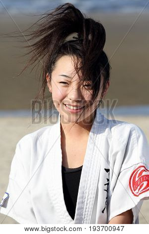 Kagawa, Japan - January 3, 2017: Japanese martial arts houses, young girl training of karate at the new year at the Ichinomiya beach.